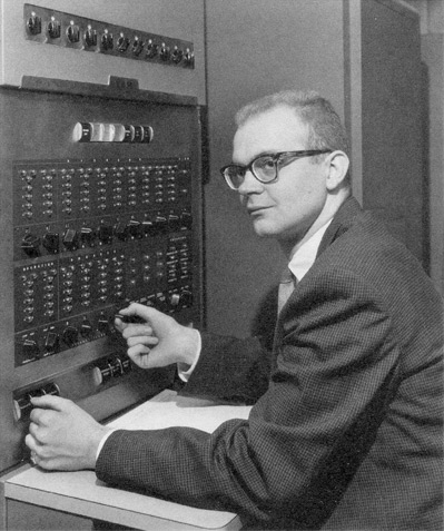 Donald Knuth, age 20, at his first IBM 650 computer in 1958